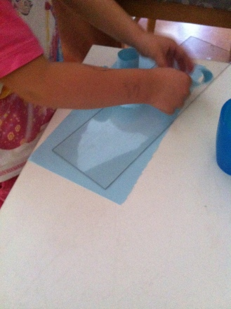 Tearing paper to make strips for circles
