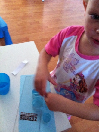 sticking strips together (we craft in our PJ's yes we do lol)